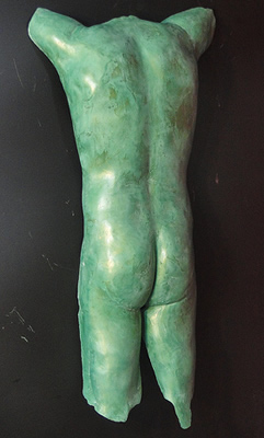 green male torso sculpture